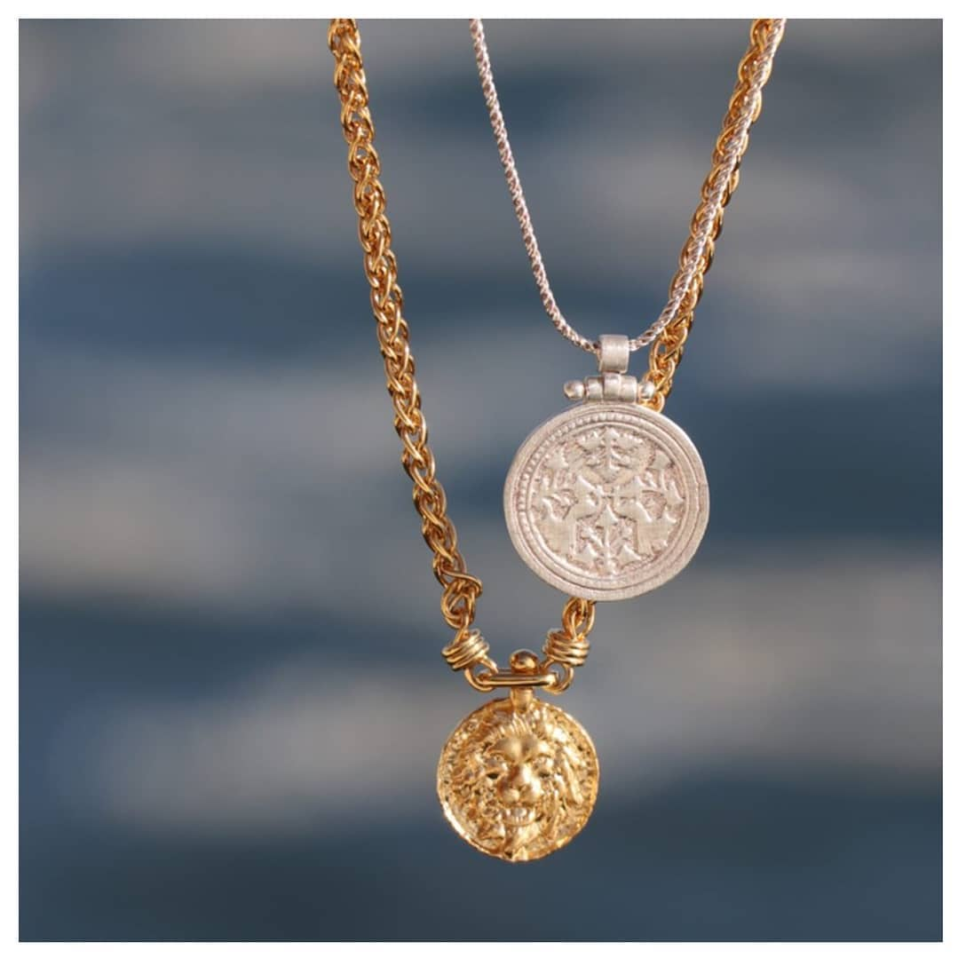 layering silver and gold necklaces