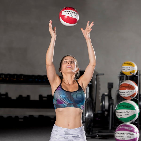 Medicine Ball Tree Rack - Single Column - Woman tossing ball overhead