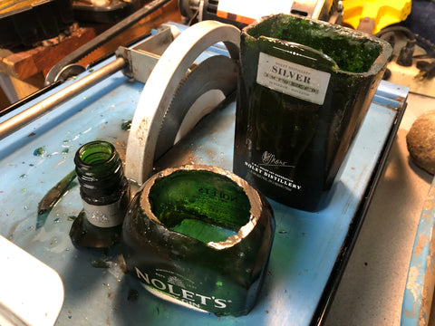 Cutting a green glass bottle on a lapidary trim saw
