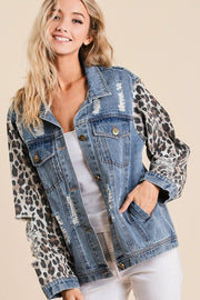 DISTRESSED DENIM JACKET WITH LEOPARD CUFFS