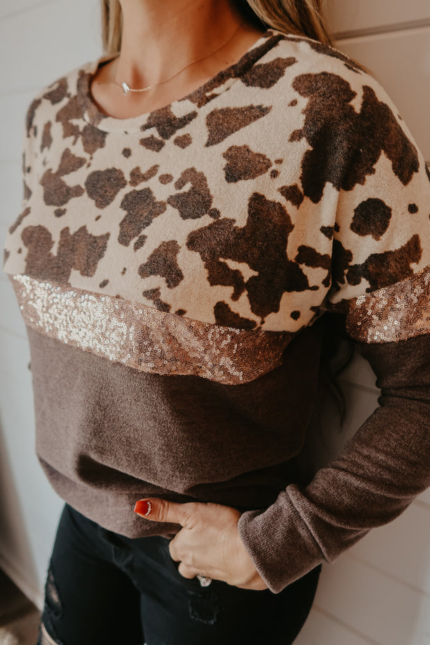 COW PRINT AND SEQUIN SWEATER TOP