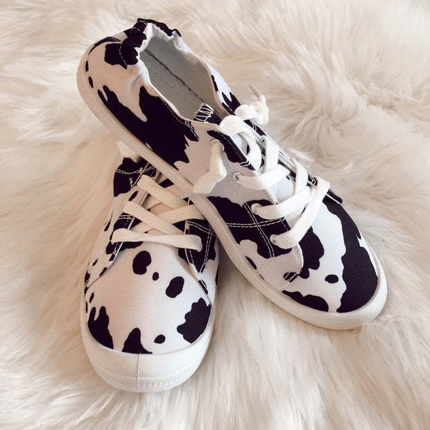 BLACK AND WHITE COW PRINT SNEAKERS