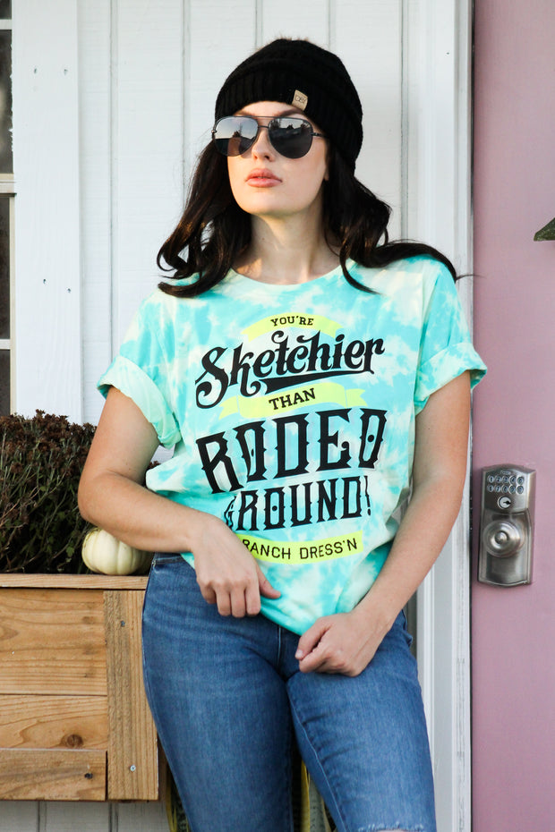 YOU'RE SKETCHIER THAN RODEO GROUND - TURQUOISE TIE DYE TEE