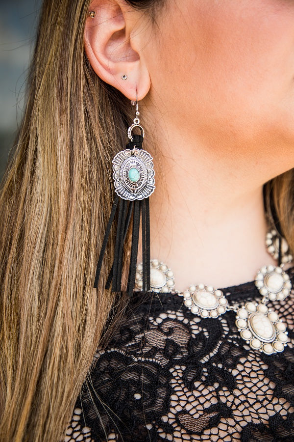 BLACK SUEDE FRINGE EARRINGS WITH CONCHO
