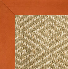 Orange binding sisal rug
