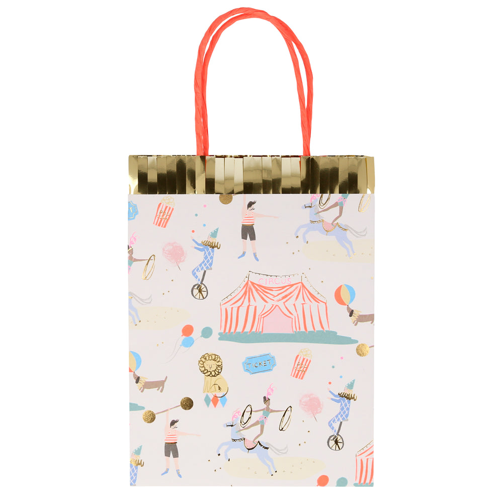 Paper party bags with a beautifully illustrated circus print theme including a big circus tent, jugglers, strongman, dog, performing pony, lion, popcorn and ticket to the circus