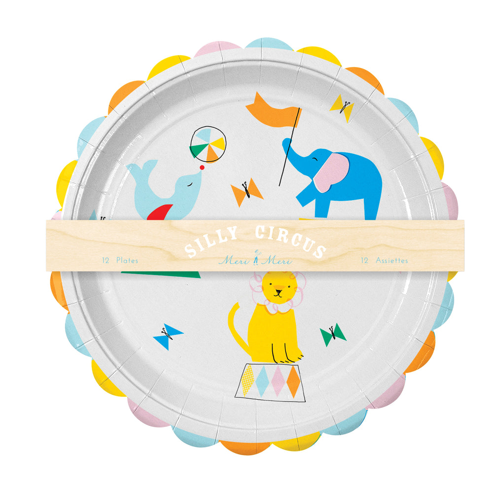 pack of twelve circus themed party plates featuring performing seal, elephant and lion in bright colors with a scalloped edge, nine inch diameter
