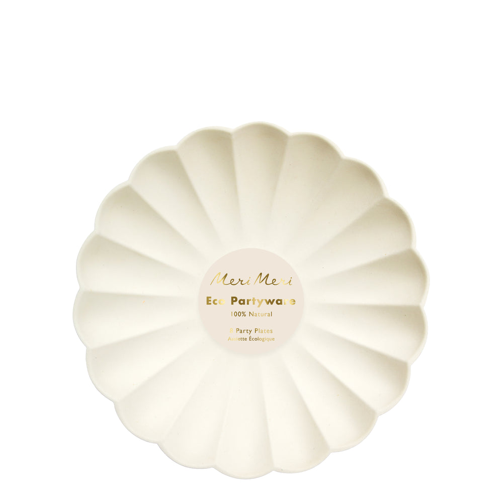 cream eco plates are made from all natural materials - pulp from bamboo, wood fiber and sugarcane and colored using water-based ink dyes. They are molded into an elegant curved shape, with a scalloped edge. Package of eight plates