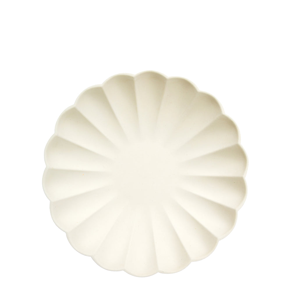 cream eco plates are made from all natural materials - pulp from bamboo, wood fiber and sugarcane and colored using water-based ink dyes. They are molded into an elegant curved shape, with a scalloped edge.