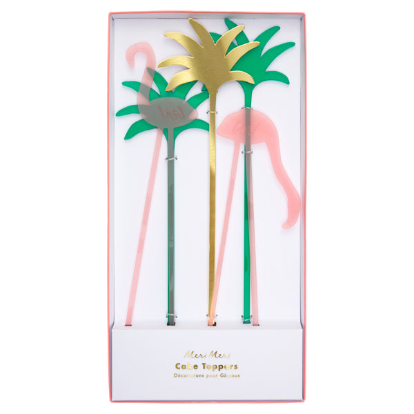 pink flamingo cake toppers made from acrylic, includes two green and one gold abstract palm trees package in a box with a clear top.