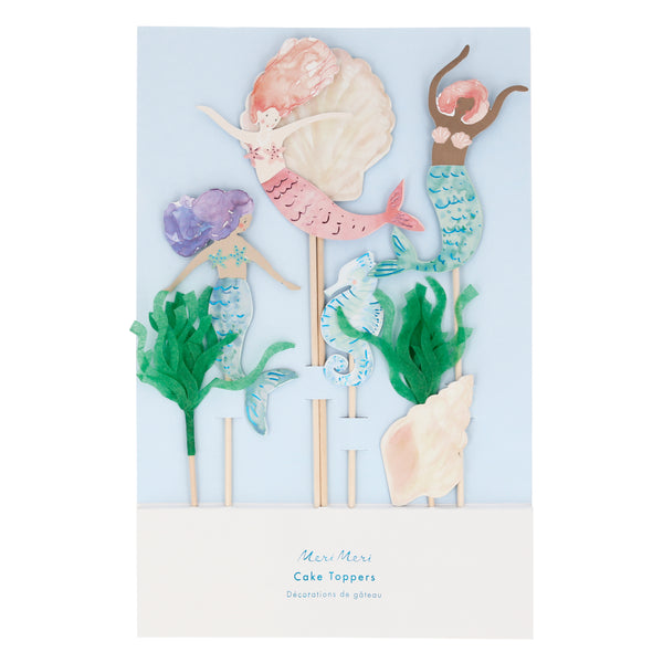 beautifully illustrated cake toppers featuring three mermaids, two seashells, a seahorse made from paper cardstock and two seaweed toppers made with green tissue paper. set of seven toppers on bamboo slender sticks