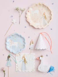 Create the perfect princess party with the Magical princess party collection by Meri Meri includes plates,cake topper,wands,party hats and pinata favors.