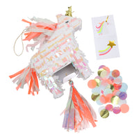 mini unicorn pinata made with iridescent paper and pre-filled with multi-colored confetti and one unicorn and one shooting star temporary tattoos and space for extra small treats