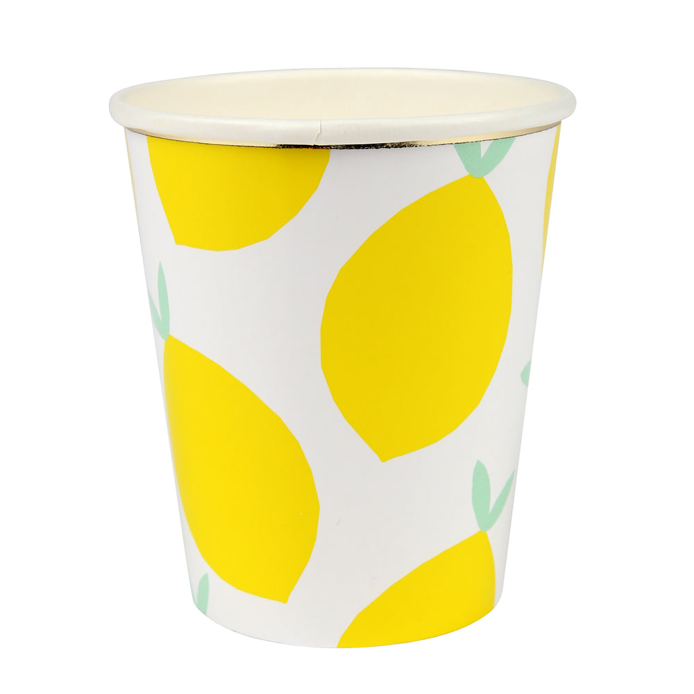 white cups with bright yellow lemon print and embellished with a gold band at the brim of each cup