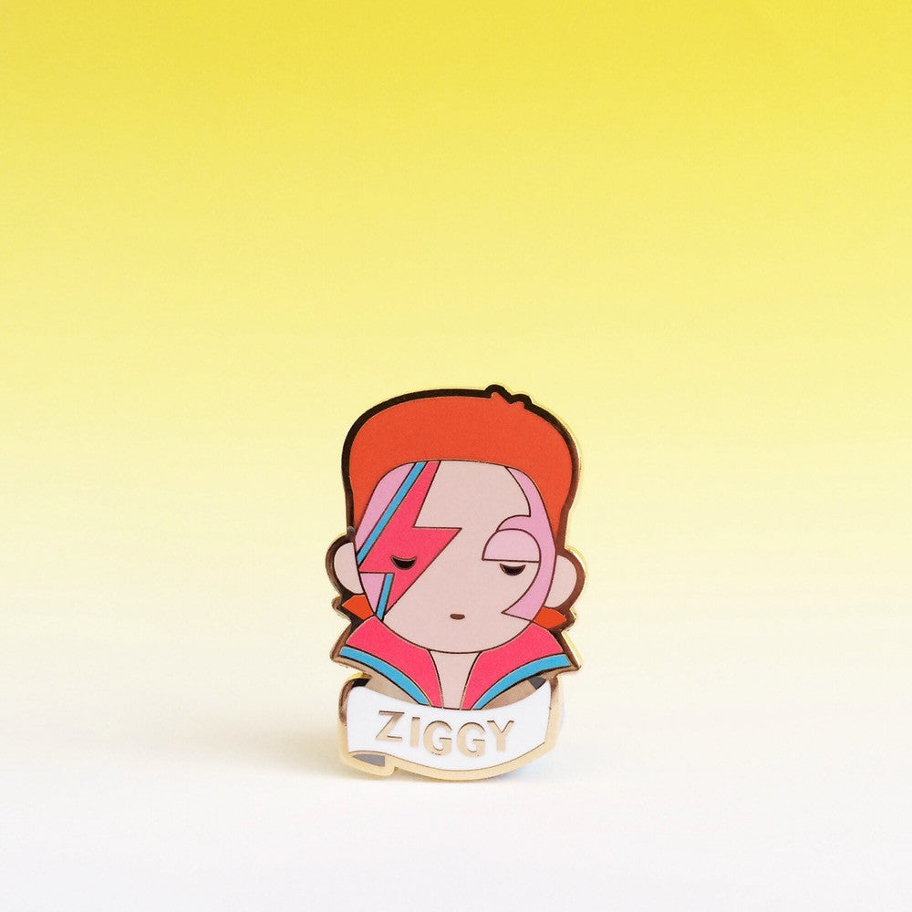 "David Bowie better known as "" Ziggy "" enamel brooch is a colorful accessory perfect for a gift or party favor"