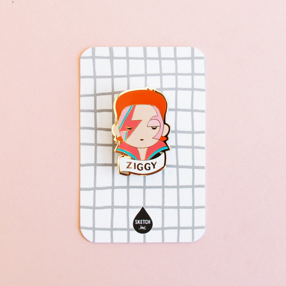 "David Bowie "" Ziggy "" enamel brooch packaged on a windowpane card is the perfect gift or party favor"