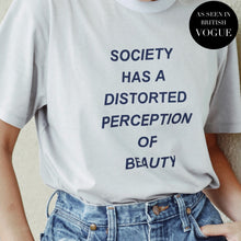 Blue t-shirt with dark blue slogan - society has a distorted perception of beauty.