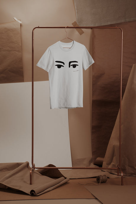White Carnaby's Eyes Outline Organic T-shirt on a Copper hanger.