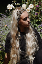 Blonde woman wearing an Ararose Carmen Headband in a garden.