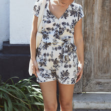 Woman wearing Hannah Floral print playsuit outside.