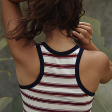 Back view of woman wearing Ararose Isla striped red and white tank top with blue edging outside.