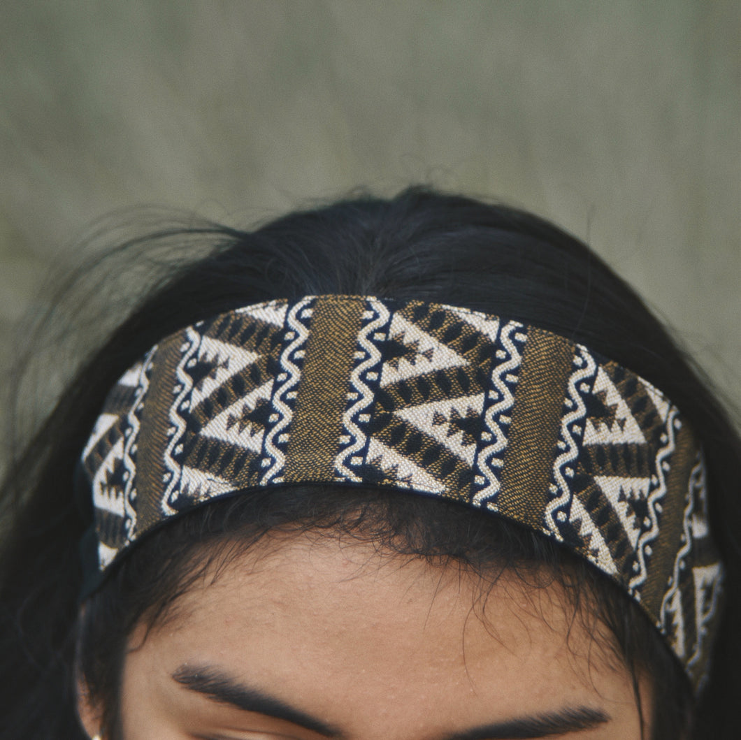 Close up of a brunette woman wearing a Ararose Carmen headband.