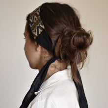 Back view of a brunette woman wearing an Ararose Carmen Headband.