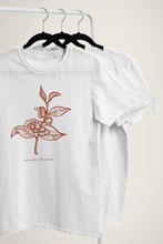 White Carnaby's Plant Magic organic t-shirts  hanging on a black hanger.
