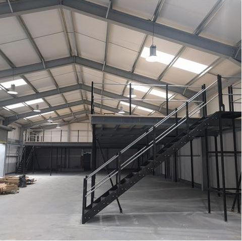 A brand new mezzanine floor stands proud in a large warehouse