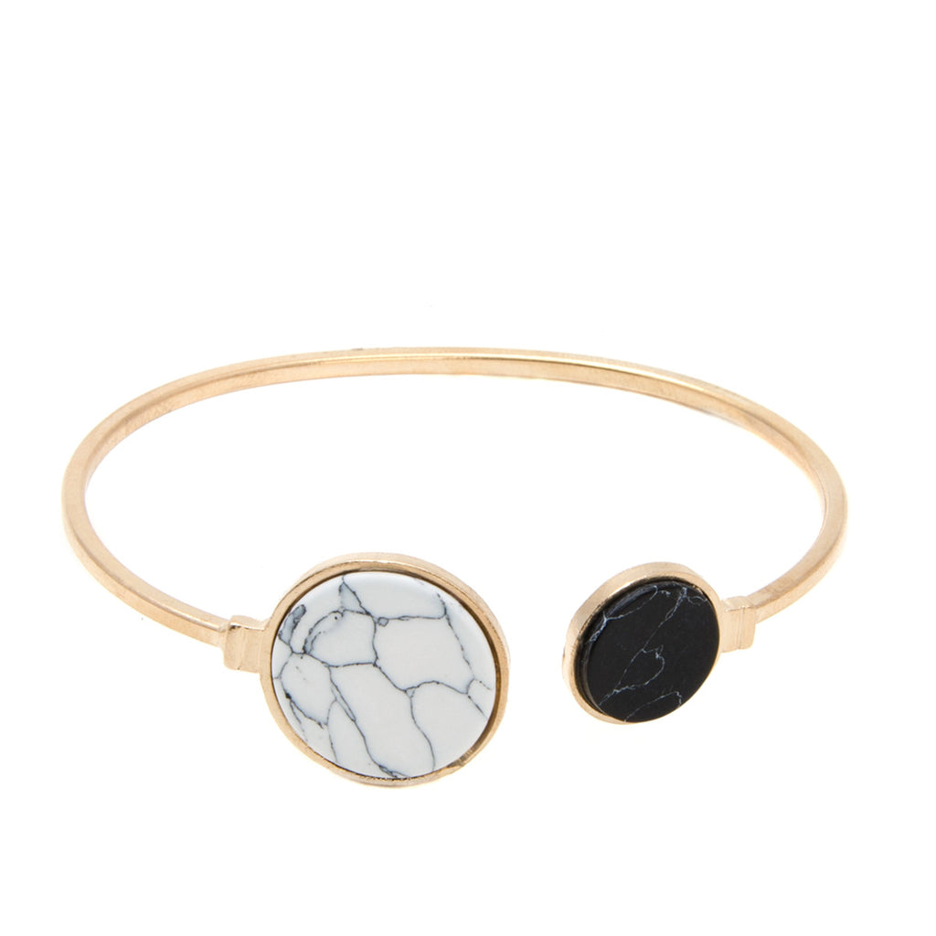 womens gold open cuff bangle with black and white marble semi precious stone detail