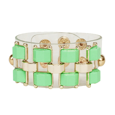 womens modern clear pvc cuff bracelet with gold metal work and mint green stud detail