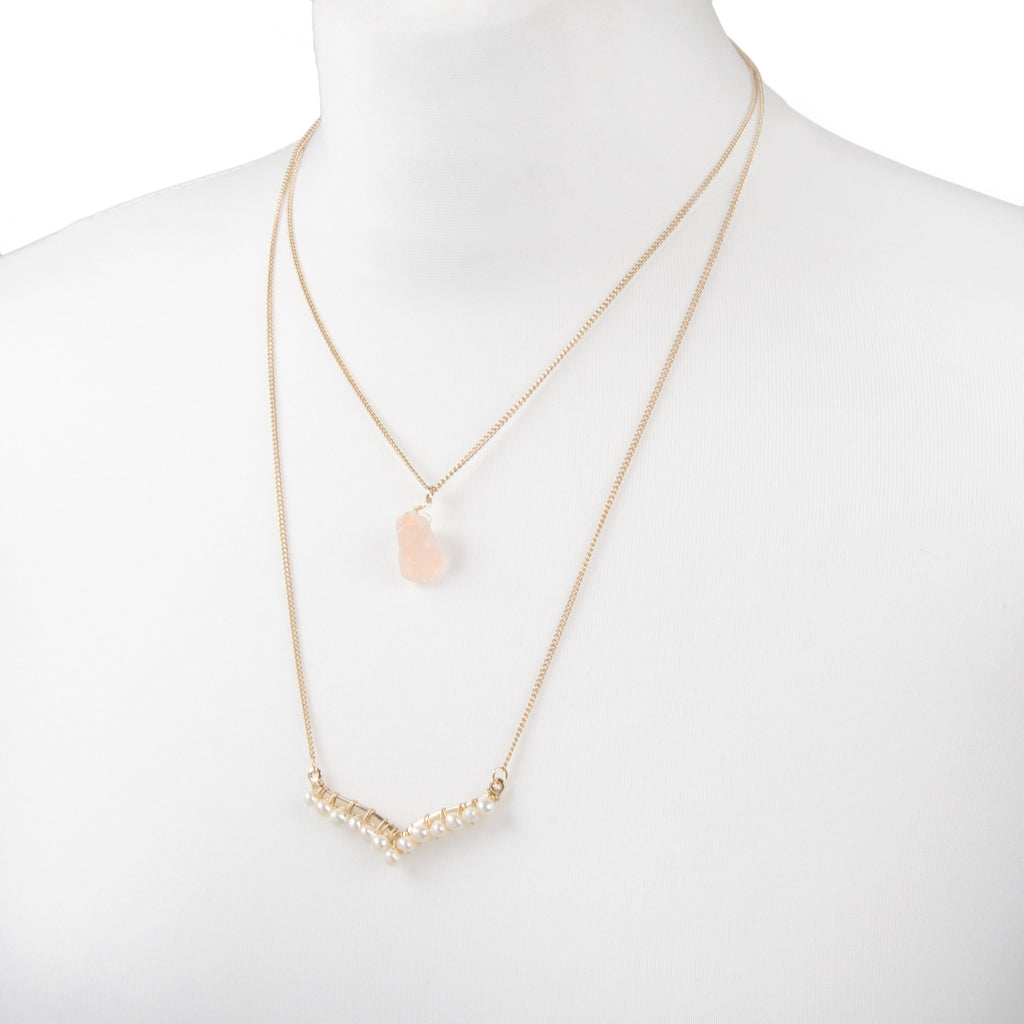 gold delicate layered necklace with pink semi precious stone detail and pearl pendant