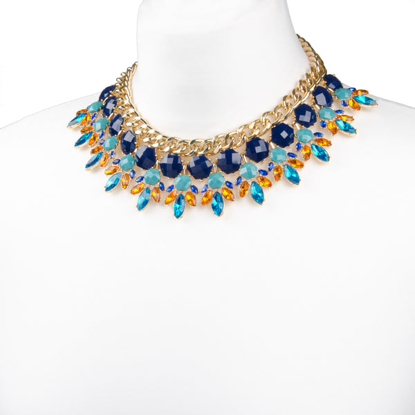 Gold chunky geometric collar necklace with navy, teal and amber brightcoloured rhinestones and chunky gold chain