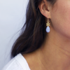 14kgold-small-spoked-hexagon-blue-lace-agate-earrings-on-model