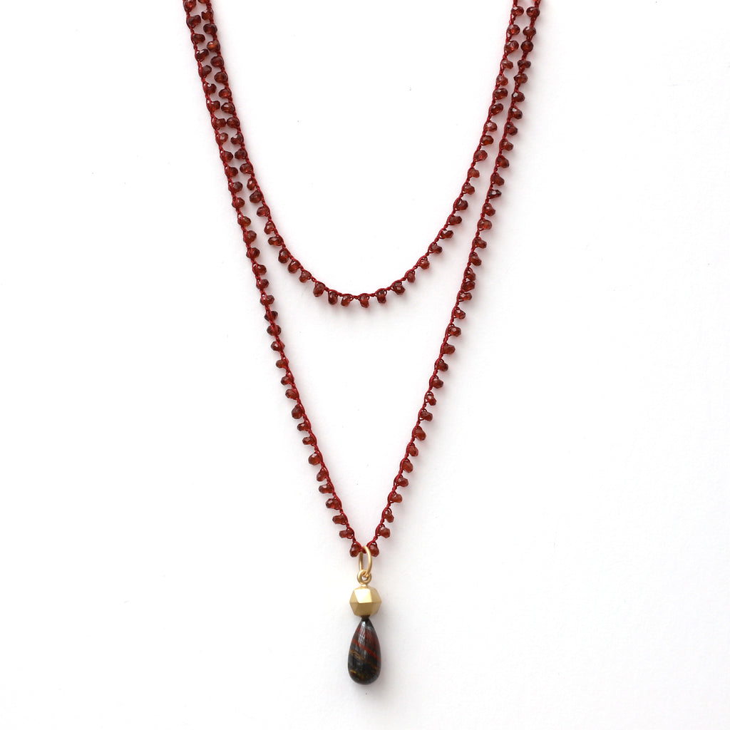 Garnet Necklace with Gold Faceted Sphere and Tiger Iron Charm