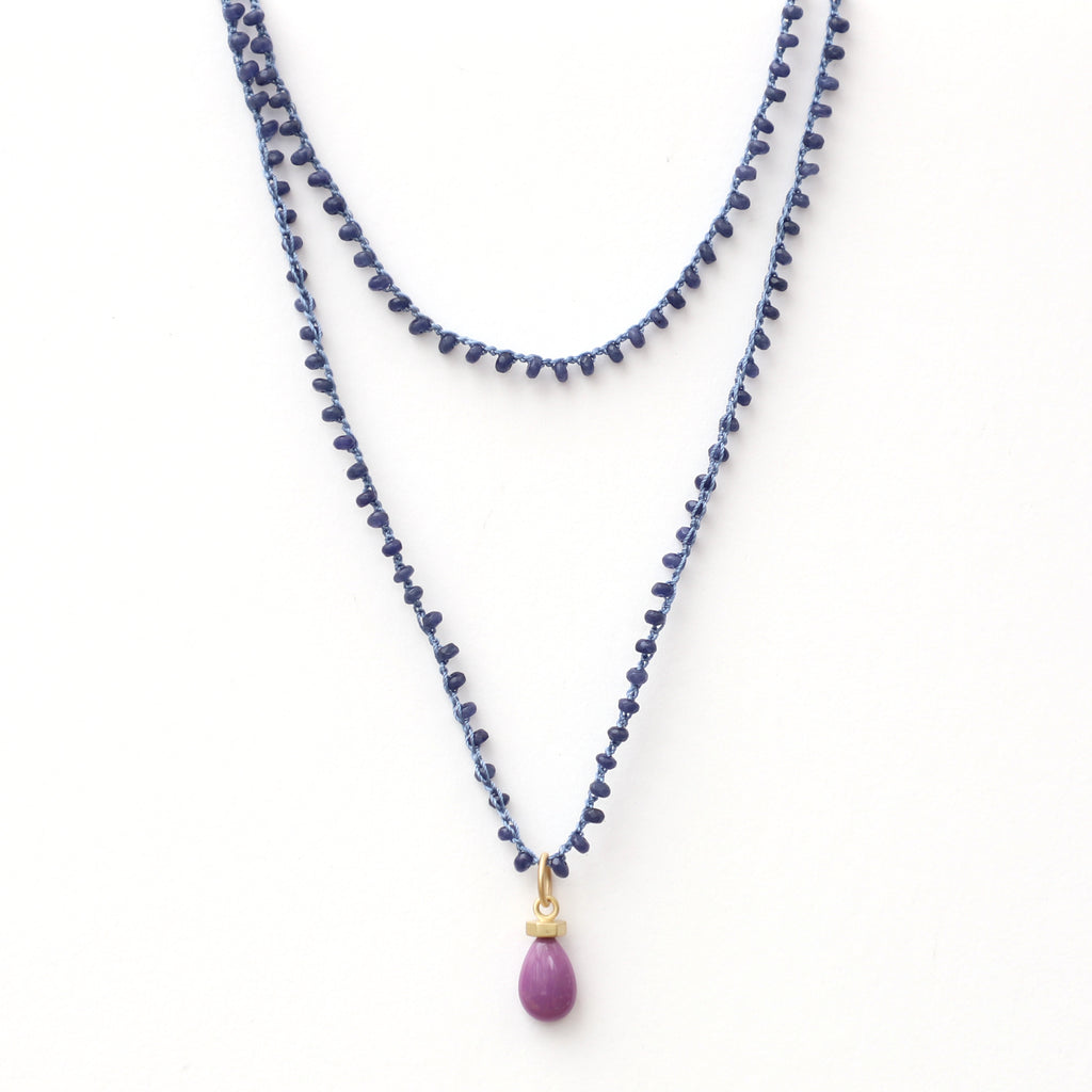 long-sapphire-jade-gemstone-necklace-with-14kgold-and-phosphosdiertie-charm