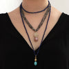 two-long-gemstone-necklaces-with-14kgold-charm-on-model
