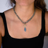 long-gemstone-necklace-with-14kgold-charm-on-model