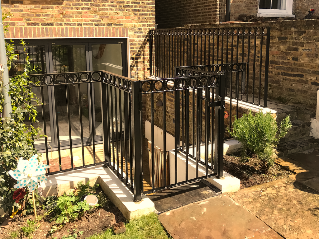 Bespoke back garden railing with gate