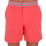 Neon coral swim trunk on model front view
