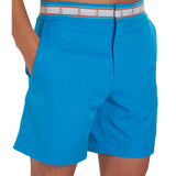 Turquoise blue swim trunk on model with hands in pockets