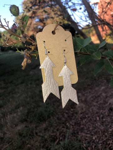 Metallic leather arrow earrings by Pretty Cactus