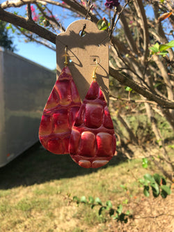 Large red textured earrings by pretty cactus