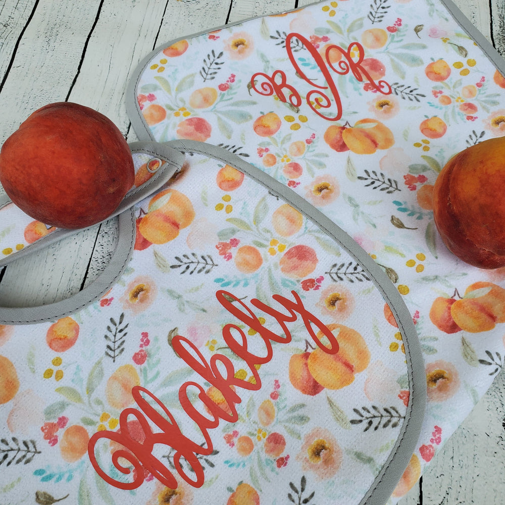 "alt=""monogrammed peach baby burp cloth"""