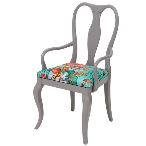 The Fifi dining chair upholstered in Flamingo print finished in Grey paint.