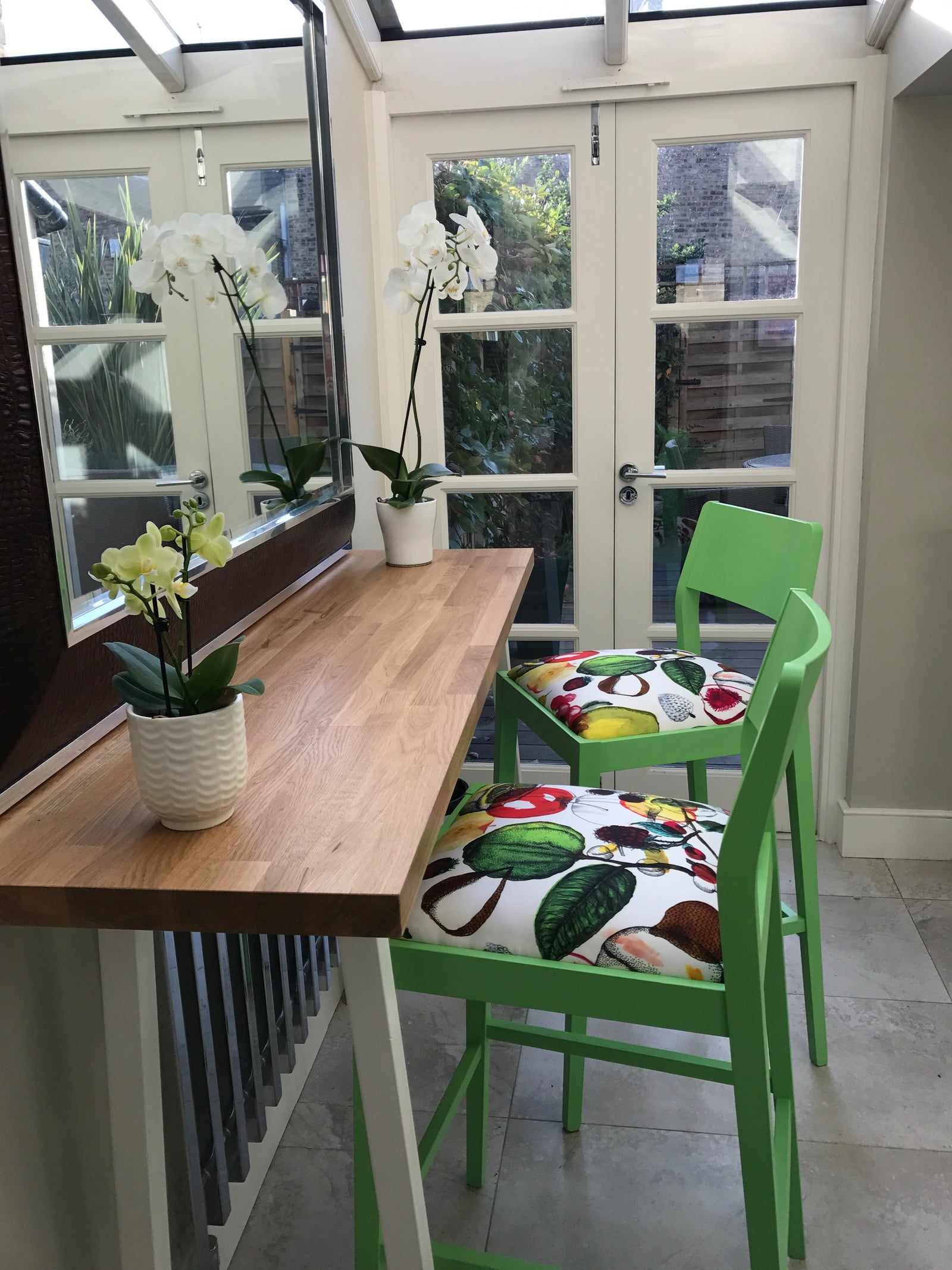 The James design bar stool upholstered in Christian Lacroix print finished in Green.