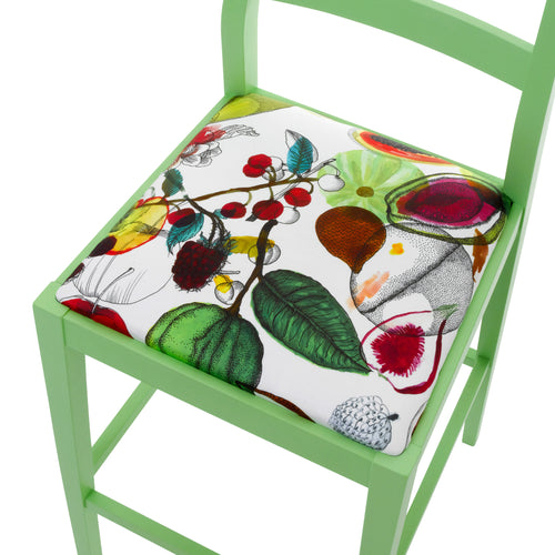 Seat view of the Christian Lacroix fabric upholstered onto a James designer bar stool finished in Green.
