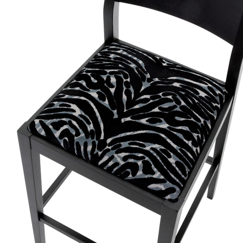Seat view of the James Bar Stool upholstered in Soft Pantigre Onyx finished in matte black.