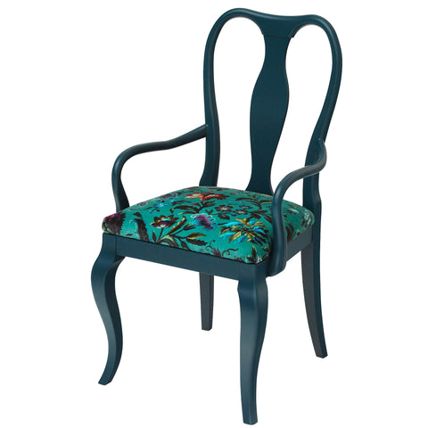 The Marco Chair upholstered in Deep Green luxurious velvet, finished in Charcoal grey