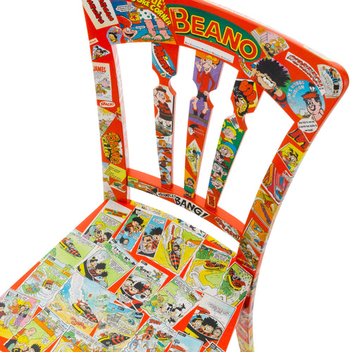 Seat view of Pop art chair finished in red overlaid with real Beano comic print